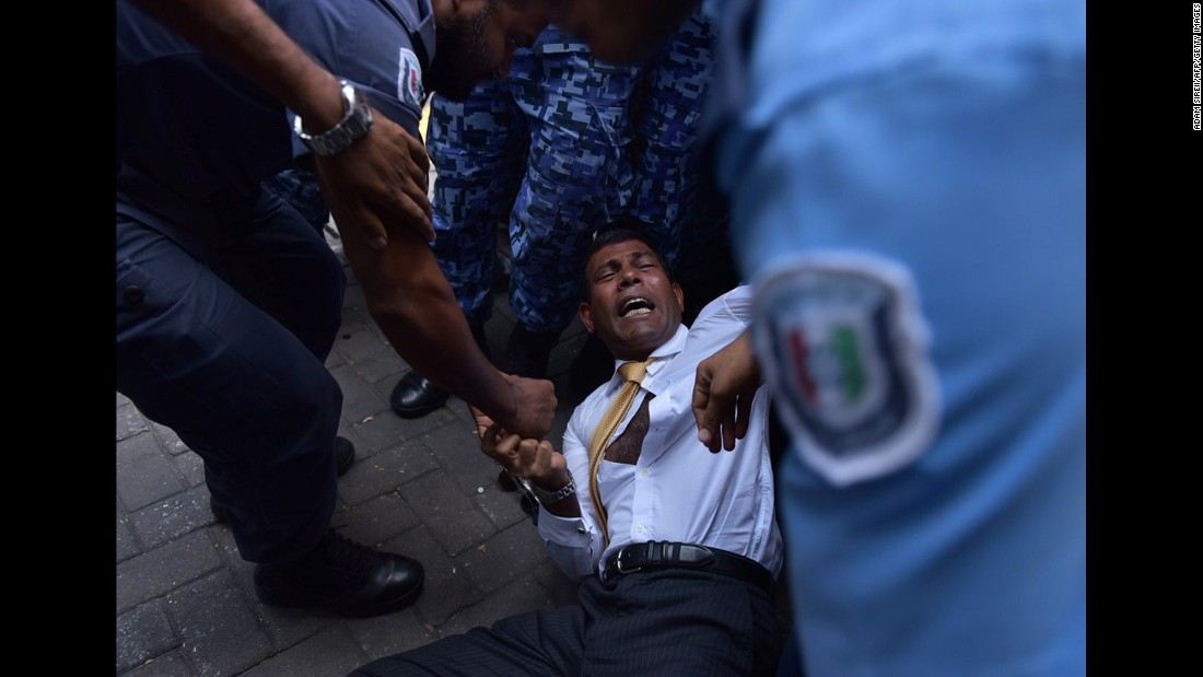 "Former Maldives President Mohamed Nasheed falls during a scuffle with police as he arrives to a courthouse on Monday, February 23. The court refused him bail and access to his lawyers, his party said, <a href=""http://www.theguardian.com/world/2015/feb/23/former-maldives-president-mohamed-nasheed-denied-bail-terrorism-charges"" target=""_blank"">according to the Guardian</a>."
