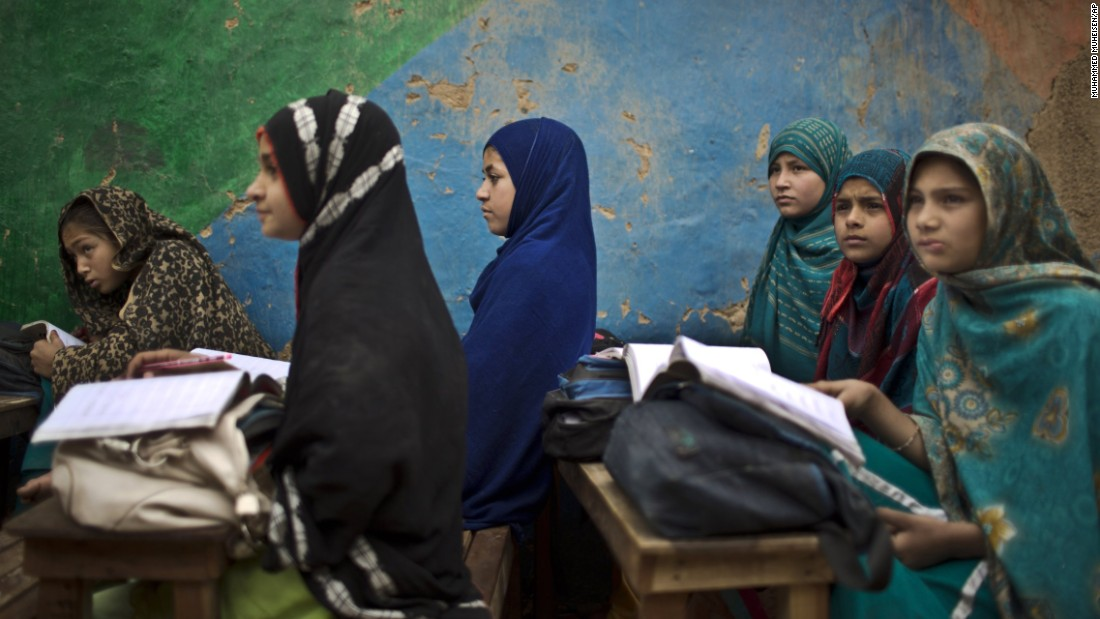 Afghan refugees attend a class at a makeshift school on the outskirts of Islamabad, Pakistan, on Monday, February 23.