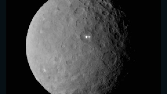 NASA's Dawn spacecraft began orbiting the dwarf planet Ceres in March. Scientists were surprised by the large white spots shining on Ceres, seen above. On its way to Ceres, Dawn spent time studying the proto-planet Vesta in 2001. Ceres and Vesta are the two most massive bodies in the main asteroid belt between Mars and Jupiter. The mission, launched in 2007, is giving scientists new knowledge of how the solar system formed and evolved.