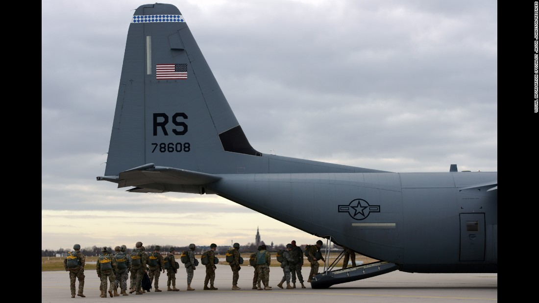 U.S. soldiers board a C-130 Hercules aircraft for a training parachute jump over a drop zone in Germany on February 24, 2015.