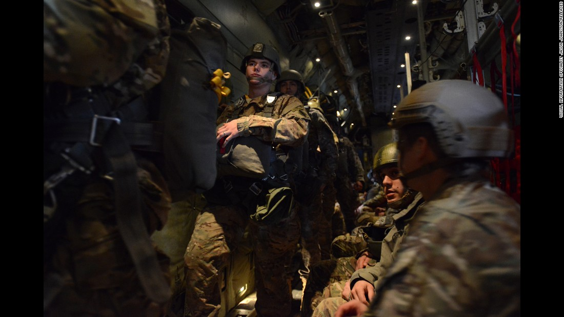 The soldiers from the 1st Battalion, 10th Special Forces Group prepare for their parachute jump.