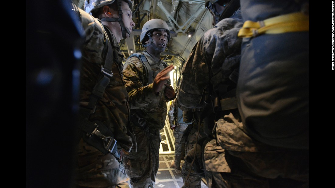 Soldiers prepare for their training parachute drop over Germany. More than 100 participated in the air drop.