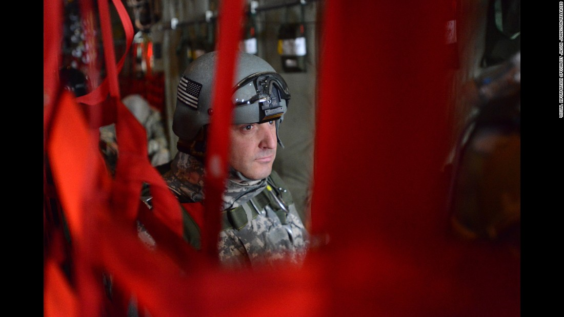 A soldier waits for a training drop to begin aboard an Air Force C-130 over Germany.