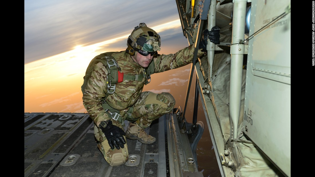 A soldier checks conditions before his fellow soldiers jump out of the C-130 Hercules aircraft over a drop zone in Germany on February 24.