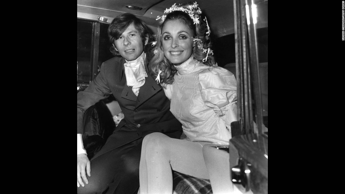 Polanski and actress Sharon Tate pose for photos after their wedding in 1968.