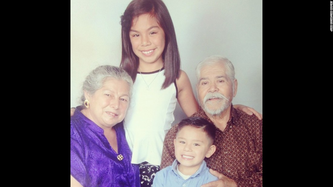 Leyah and Juanito take a photo with their grandparents, Herminio and Juanita. Herminio immigrated from Mexico in 1959.