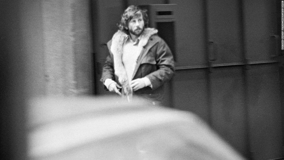 Polanski walks down a street in Paris a few weeks after he fled the United States in February 1978.