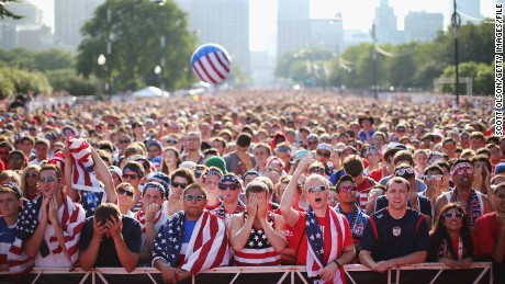 Thousands of fans gather in Chicago's Grant Park to watch the USA compete in the 2014 World Cup on big screens.