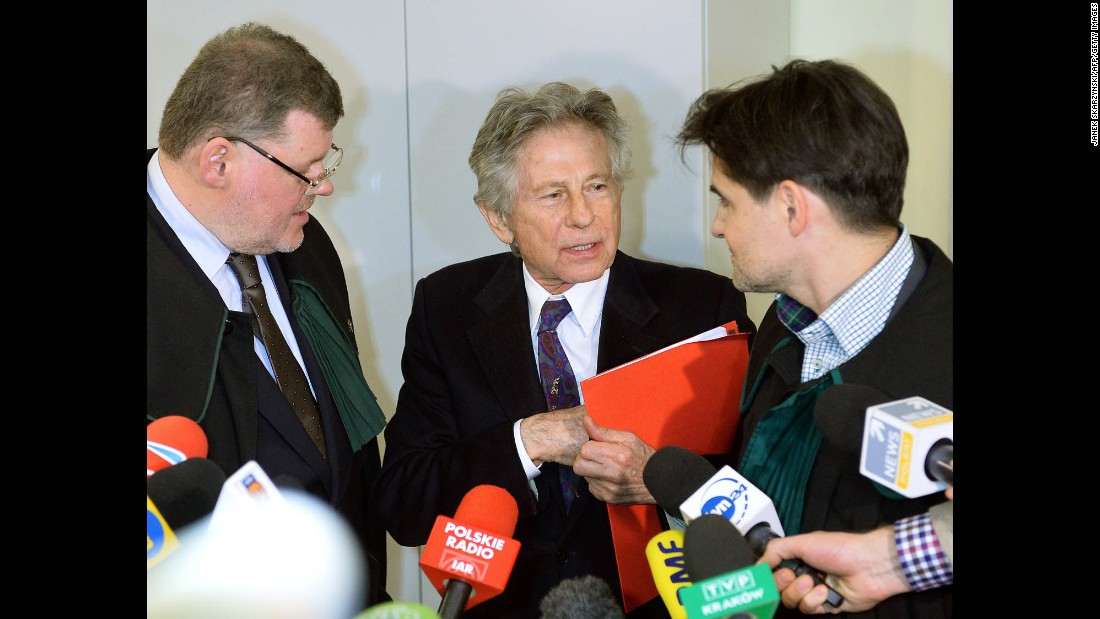 Polanski speaks with his lawyers as he leaves court in Krakow, Poland, on February 25.