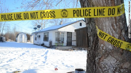 Police tape surrounds one of five crime scenes near Tyrone, Mo., on Friday morning, Feb. 27, 2015. A gunman killed seven people and wounded an eighth person in an overnight house-to-house rampage in the small town in the Missouri Ozarks before apparently committing suicide in a vehicle, authorities said Friday. The victims were found in four homes in Tyrone, about 40 miles north of the Arkansas line. The 36-year-old gunman was discovered in a neighboring county, dead of what appeared to be a self-inflicted gunshot wound, Missouri Highway Patrol Sgt. Jeff Kinder said. (AP Photo/Houston Herald, Jeff McNiell)