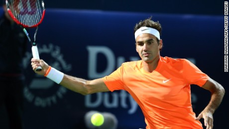 Roger Federer returns the ball to Novak Djokovic during their final match of the Dubai Championships.