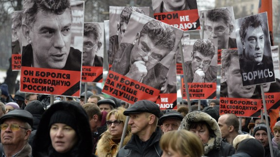 Russia's opposition supporters carry portraits of Kremlin critic Boris Nemtsov during a march in central Moscow on March 1, 2015. The 55-year-old former first deputy prime minister under Boris Yeltsin was shot in the back several times just before midnight on February 27 as he walked across a bridge a stone's throw from the Kremlin walls.