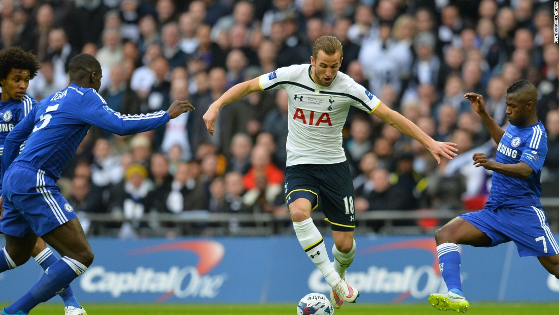 Tottenham's star young striker Harry Kane is surrounded by Chelsea defenders in the final at Wembley.