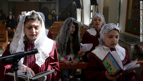 Displaced Assyrian women, who fled their homes due ISIS attacks, take part in a prayer at the Ibrahim-al Khalil Melkite Greek Catholic church on the outskirts of Damascus, Syria on March 1. ISIS militants recently abducted at least 220 Assyrians in Syria.