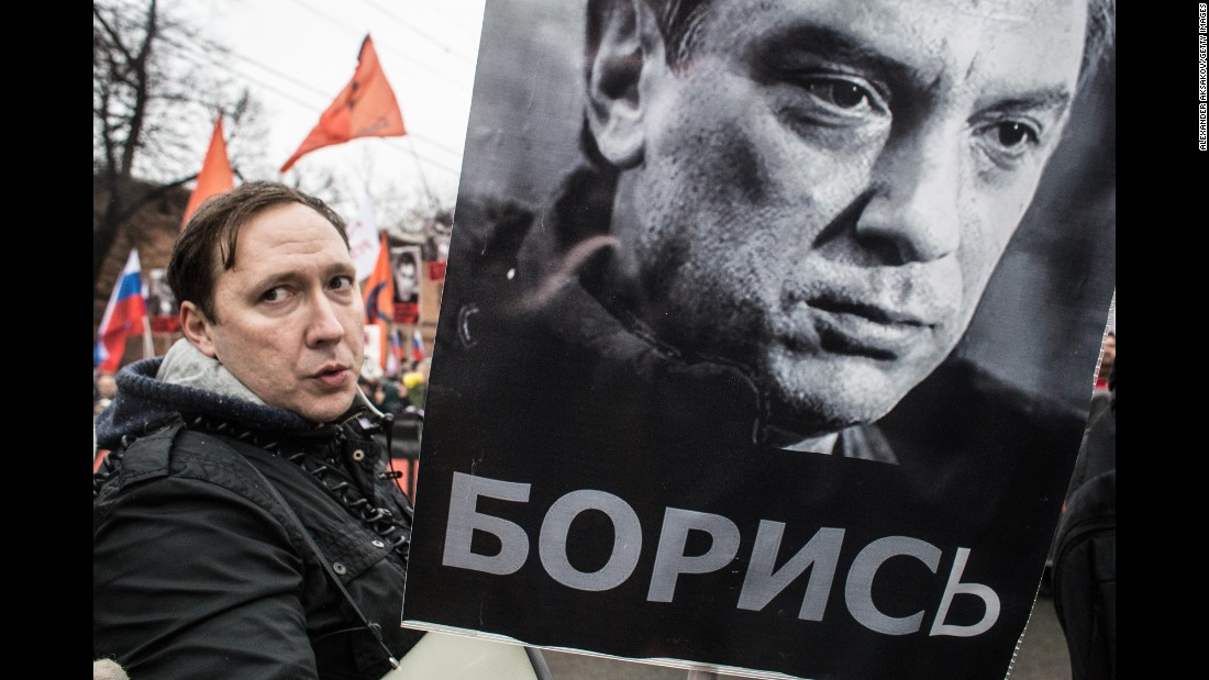 A man carries a sign with Nemtsov's image March 1 in Moscow.