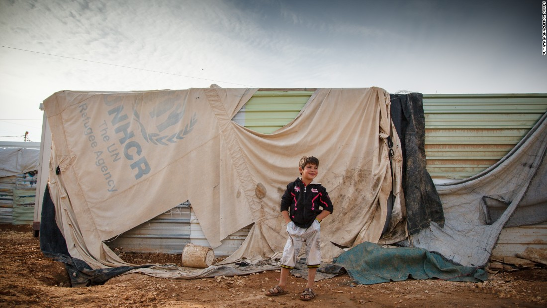 "Omer, 7, lives in Jordan's Zaatari Camp for Syrian refugees.  Omer says, ""Winter is not nice here. We step in mud and water. Snow is the worst part of winter here."" Mercy Corps delivered 17,200 tons of food and supplies into northern Syria in 2014."