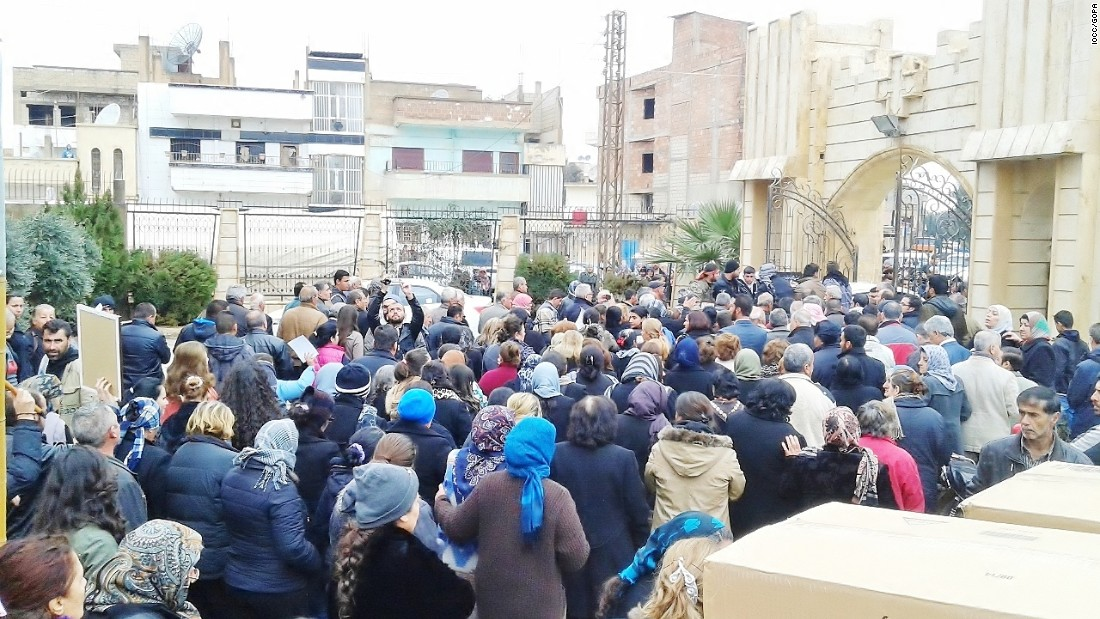 Exhausted and traumatized Christians from villages in northeastern Syria gather at an Orthodox Christian church in Hasakah, Syria, seeking refuge after their small communities were terrorized. IOCC and its church partner, the Greek Orthodox Patriarchate of Antioch and All the East, is providing food, medical attention and emergency aid to more than 1,000 displaced families.