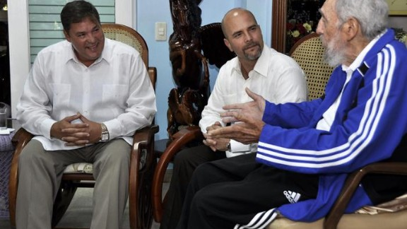 Fidel Castro, right, meets with two of the five Cuban intelligence agents formerly jailed in the United States.