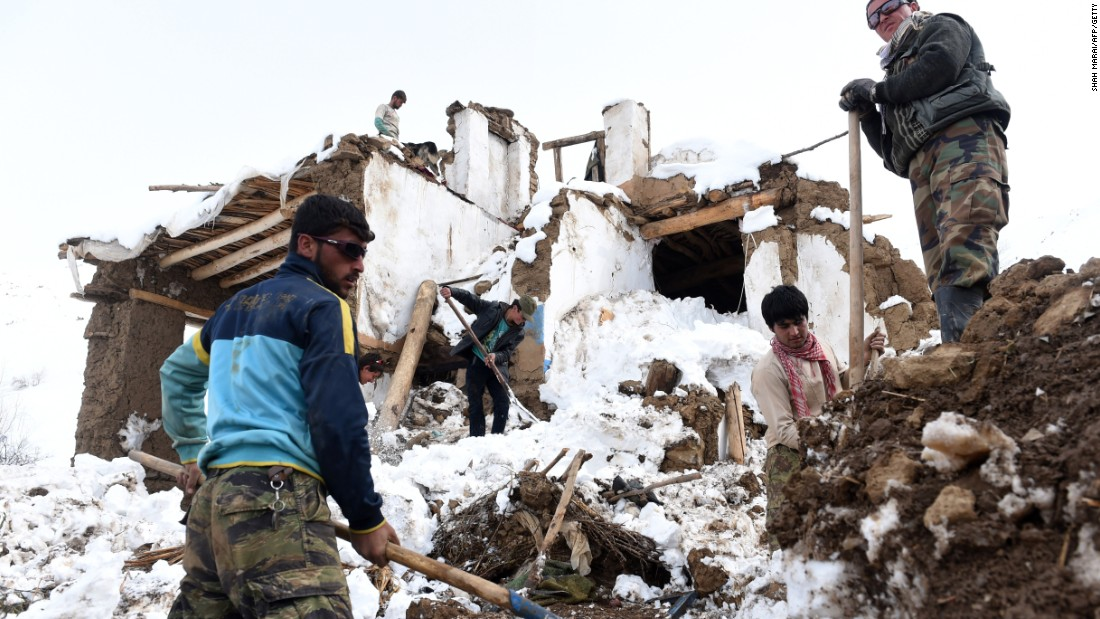 Afghan survivors of an avalanche search their destroyed houses in a village of in Panjshir province, north of Kabul on March 1. Scores of people have died in a series of avalanches in mountainous northeastern Afghanistan after heavy snowstorms.