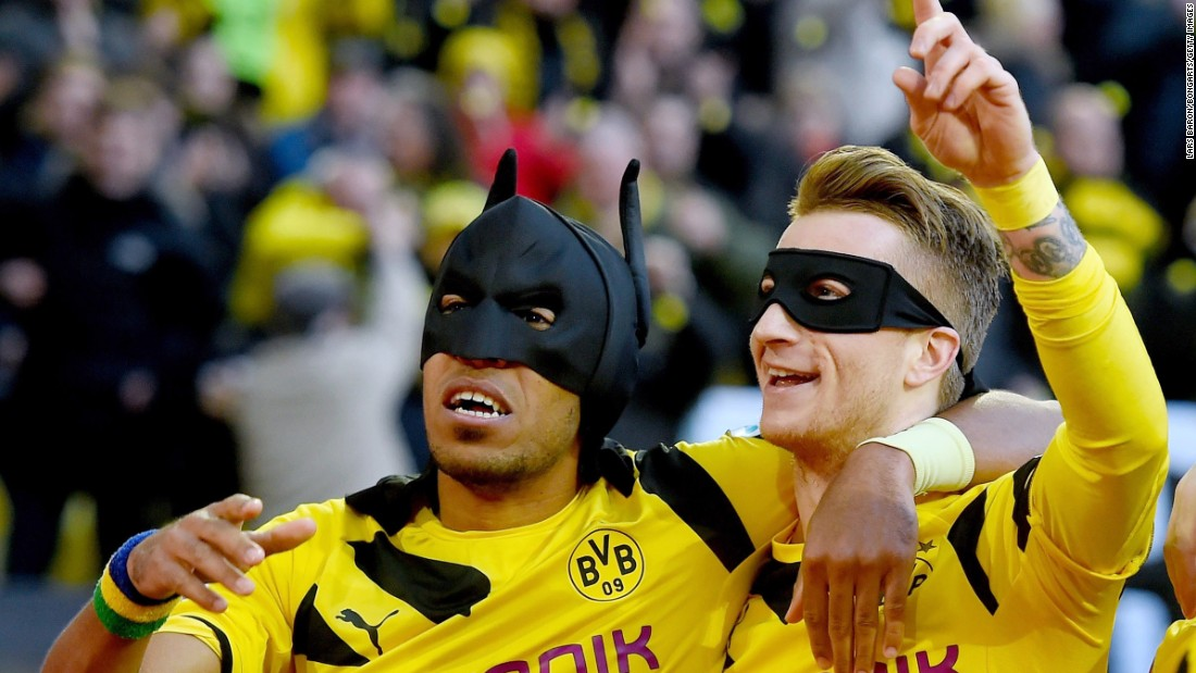Borussia Dortmund teammates Pierre-Emerick Aubameyang, left, and Marco Reus celebrate a goal with Batman and Robin masks on Saturday, February 28, during a Bundesliga match against Schalke in Dortmund, Germany. Dortmund won the Ruhr derby 3-0 with goals from Aubameyang, Reus and Henrikh Mkhitaryan.