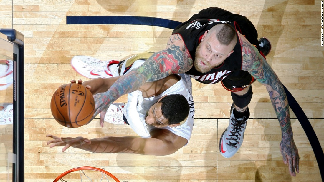 Miami's Chris Andersen, right, goes up to block the shot of Alexis Ajinca during an NBA game in New Orleans on Friday, February 27. Ajinca had a career-high 24 points as the New Orleans Pelicans won 104-102.