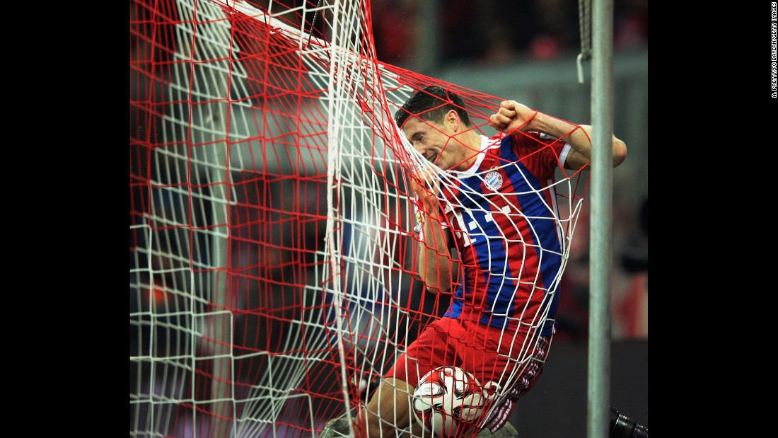 Bayern Munich striker Robert Lewandowski celebrates after scoring a goal against Cologne during a Bundesliga match played Friday, February 27, in Munich, Germany. Bayern won 4-1 to stretch its commanding lead at the top of the German league.