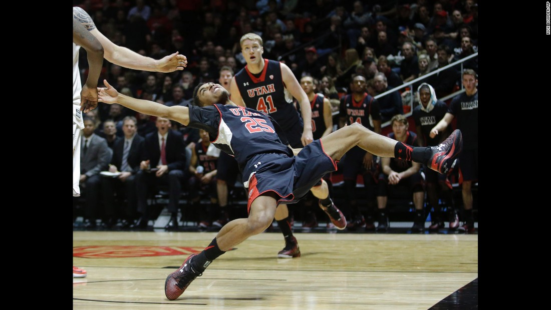 Utah guard Kenneth Ogbe falls after being fouled by Arizona State forward Eric Jacobsen during a college basketball game played Thursday, February 26, in Salt Lake City. Utah led 41-9 at halftime and won 83-41.