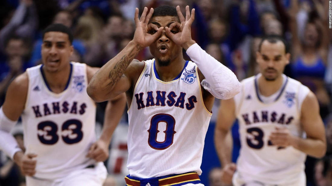 "Kansas point guard Frank Mason III puts on his ""3-point goggles"" after hitting a shot against Texas during a game Saturday, February 28, in Lawrence, Kansas. Mason's Jayhawks won 69-64."