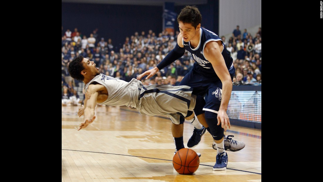 Xavier guard Dee Davis, left, draws a charge on Villanova's Ryan Arcidiacono during a college basketball game in Cincinnati on Saturday, February 28. Villanova won the game 78-66 and clinched the regular season title in the Big East Conference.