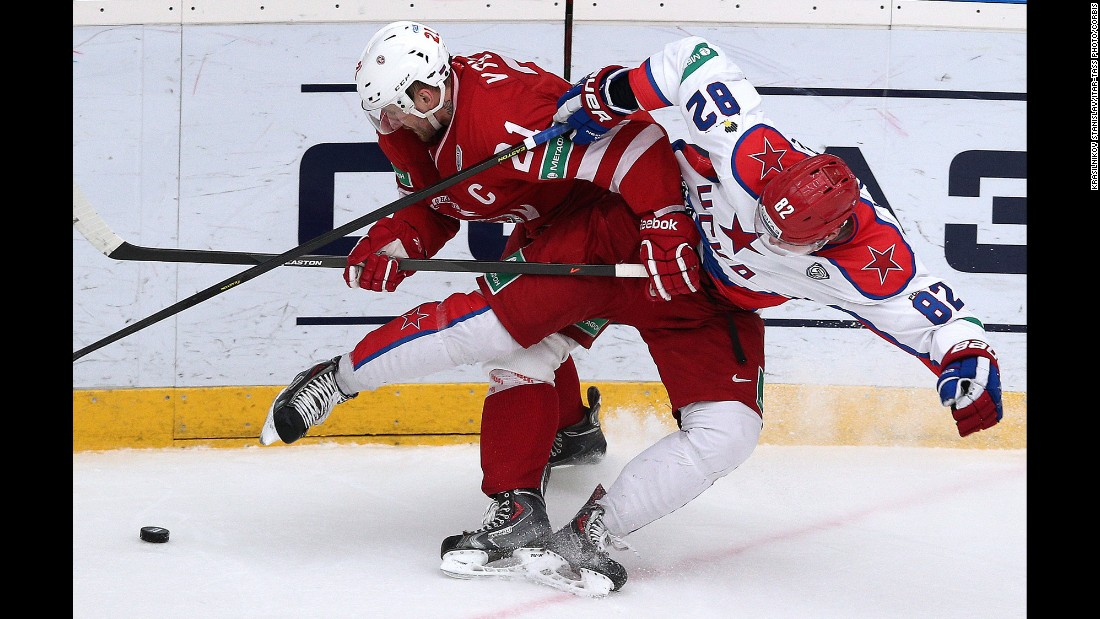 Nikita Vyglazov, left, and Ondrej Nemec battle for the puck during a KHL hockey game in Moscow between Vyglazov's Vityaz and Nemec's CSKA on Tuesday, February 24.
