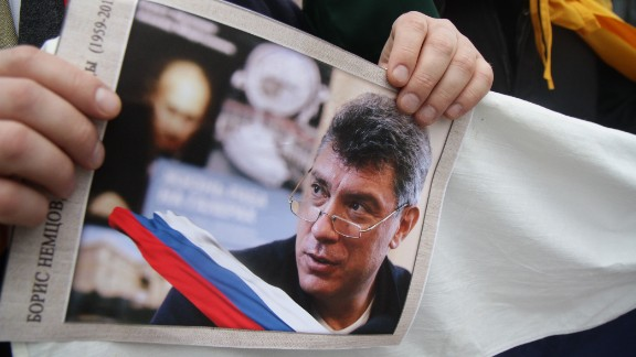 People participate in a march in memory of murdered Kremlin critic Boris Nemtsov in Vilnius on March 1, 2015. The 55-year-old former first deputy prime minister under Boris Yeltsin was shot in the back several times just before midnight on February 27 as he walked across a bridge a stone's throw from the Kremlin walls. AFP PHOTO / PETRAS MALUKAS (Photo credit should read PETRAS MALUKAS/AFP/Getty Images)