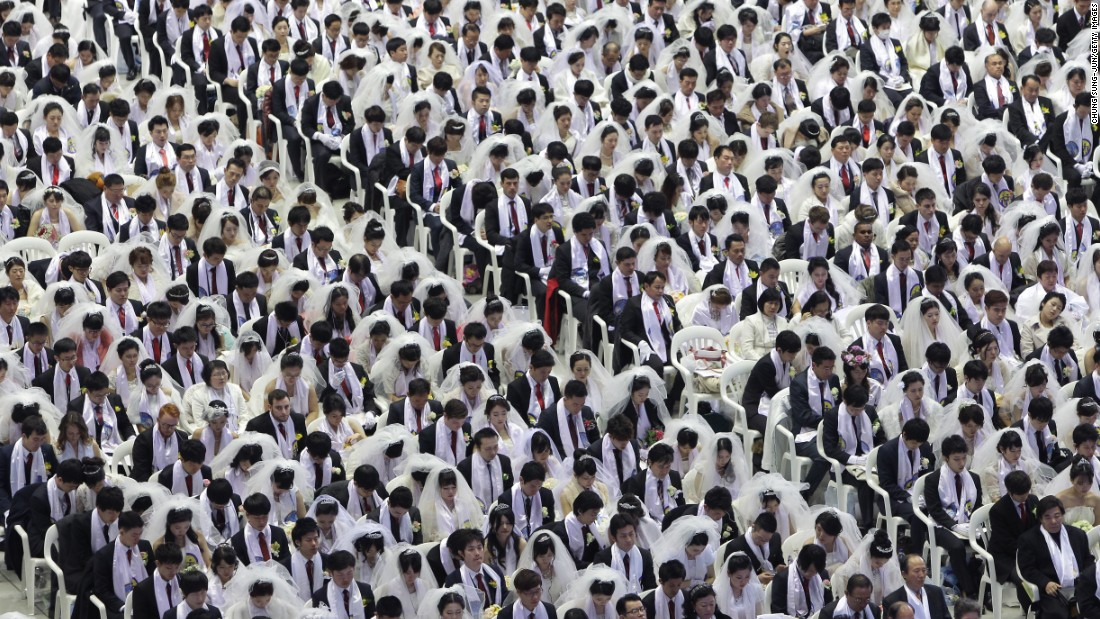 MARCH 3 - GAPYEONG-GUN, SOUTH KOREA: Thousands of couples take part in a mass wedding of the Family Federation for World Peace and Unification, commonly known as the Unification Church, at Cheongshim Peace World Center. Approximately 3,800 couples from around the world exchanged their vows in the wedding claimed by the Church to be one of its largest ever.