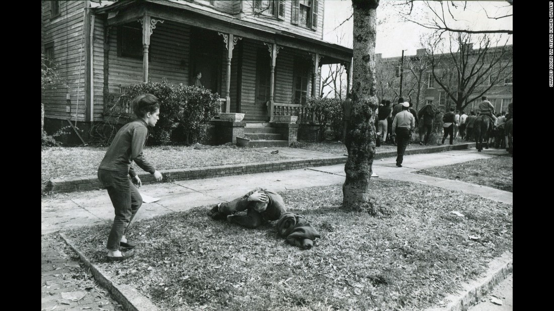 Pam Clemson rushes to the aid of a fellow demonstrator who was felled by a blow to the head in Selma.