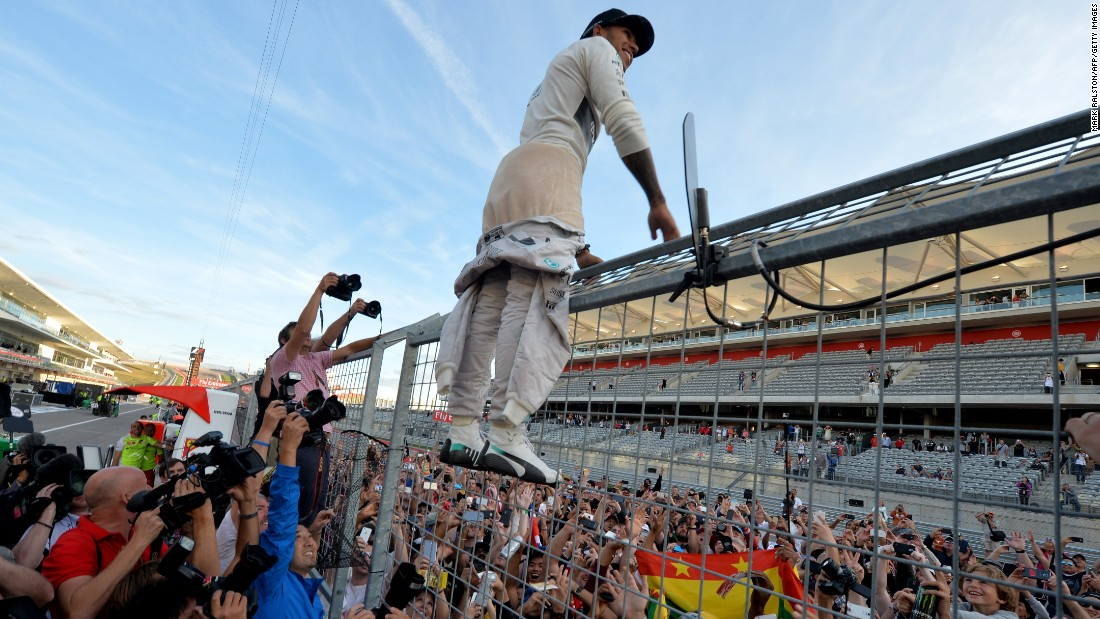 "Hamilton takes an unusual route to meeting fans after winning the U.S. Grand Prix in 2014. ""He sees his fans are the core of his power base,"" says Tom Roope, whose company The Rumpus Room helps to run Hamilton's digital media."