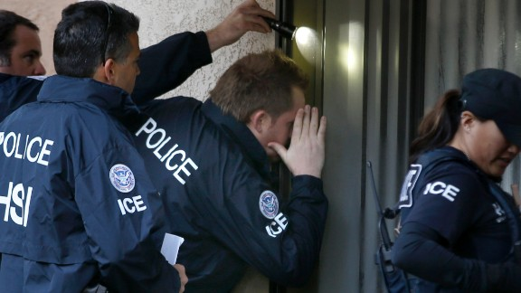 ROWLAND HEIGHTS, CA. - MARCH 3: Immigration and Customs Enforcement (ICE) agents from the Department of Homeland Security look into the window of an apartment while executing search warrants during an ongoing investigation of alleged birth tourism centers on March 3, 2015 in Rowland Heights, California. Agents from multiple federal and local law enforcement agencies executed search warrants in Orange, Los Angeles and San Bernardino counties on Tuesday morning. (Photo by Mark Boster/Los Angeles Times via Getty Images)
