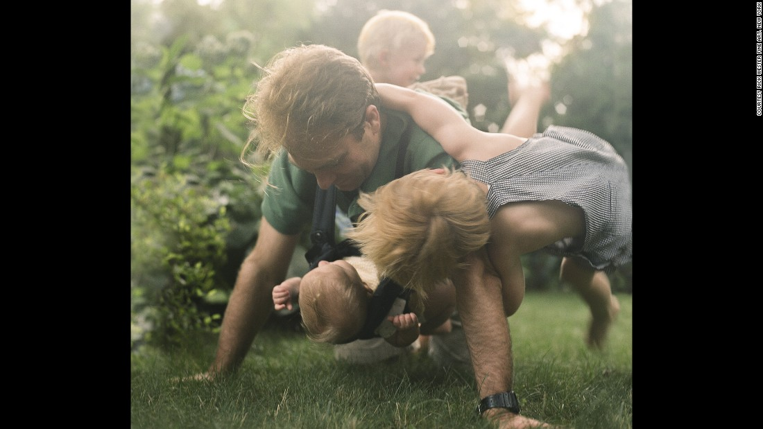 "Harper's husband, Christopher, plays with their children in 2011. ""The Home Stage"" explores parenting and childhood."