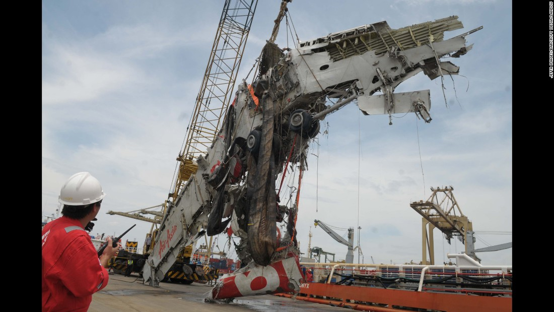 The fuselage is lifted from the Java Sea during the recovery mission on March 2.