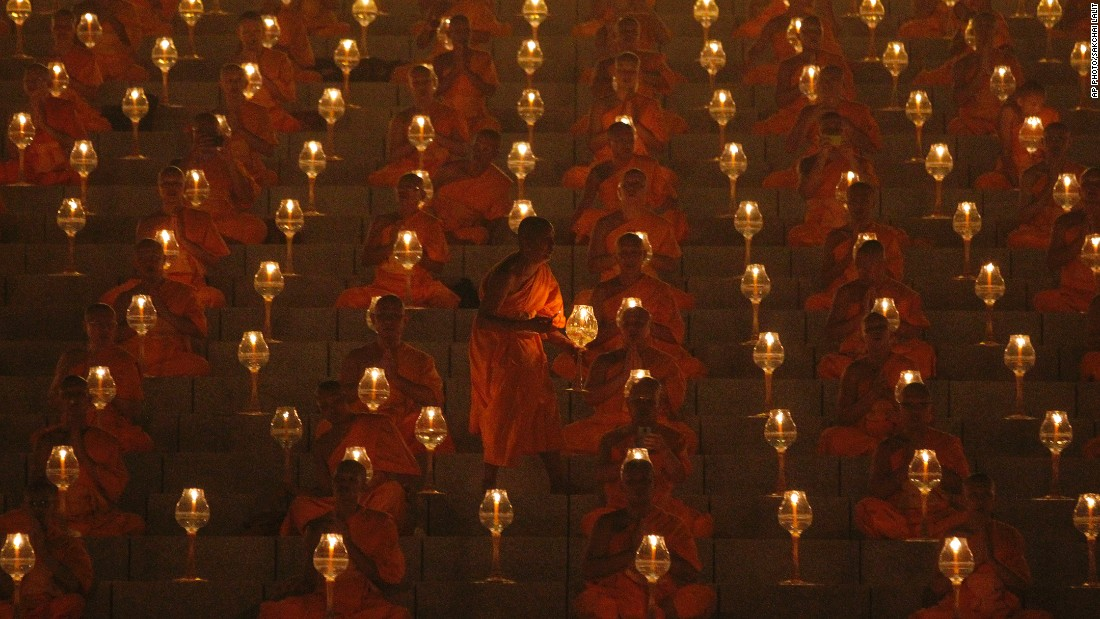 MARCH 4 - PATHUM THANI PROVINCE, THAILAND: Buddhist monks pray and gather at Wat Phra Dhammakaya temple to participate in Makha Bucha Day ceremonies. The religious holiday marks the anniversary of Buddha's mass sermon to the first 1,250 newly ordained monks.