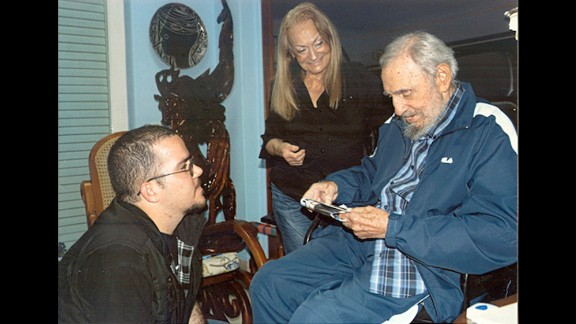 In this picture provided by CubaDebate, Castro talks to Randy Perdomo, president of Cuba