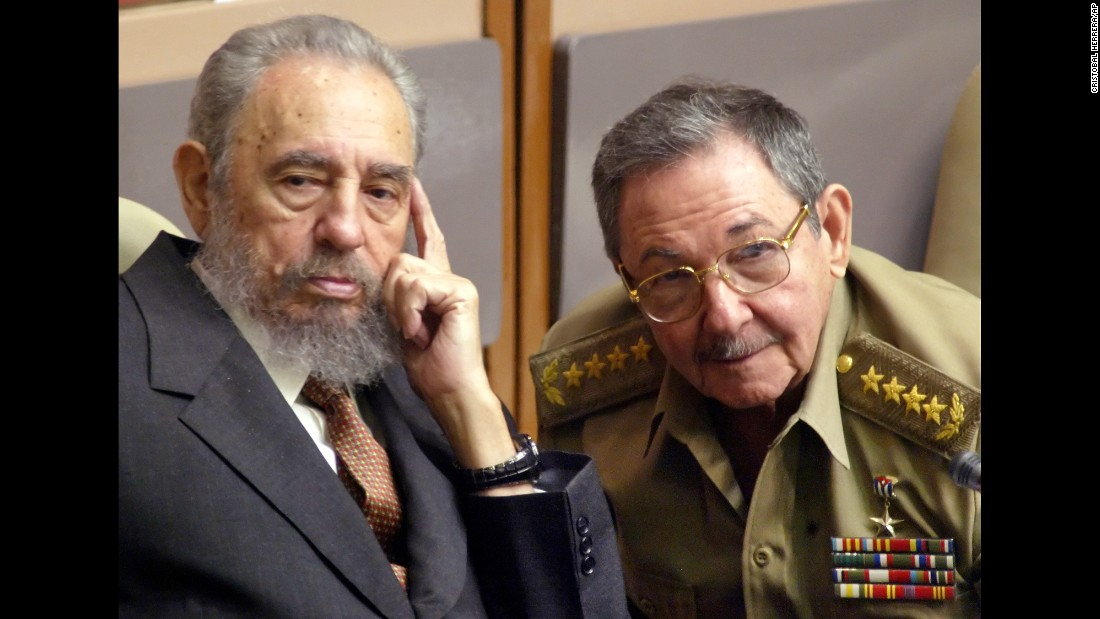 Castro, left, and his brother Raul attend a session of the Cuban parliament in July 2004.