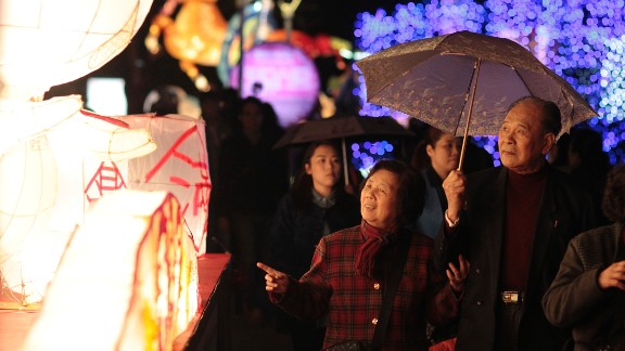 Visitors walk through a display of elaborate lanterns at the start of the Lantern Festival marking the end of Chinese Lunar New Year celebrations in Taipei on March 5.