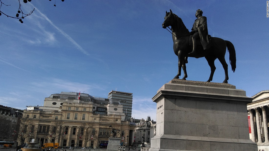 The bronze sculpture as seen from the east of Trafalgar Square with the equestrian statue of George IV in the foreground which was unveiled in 1843.