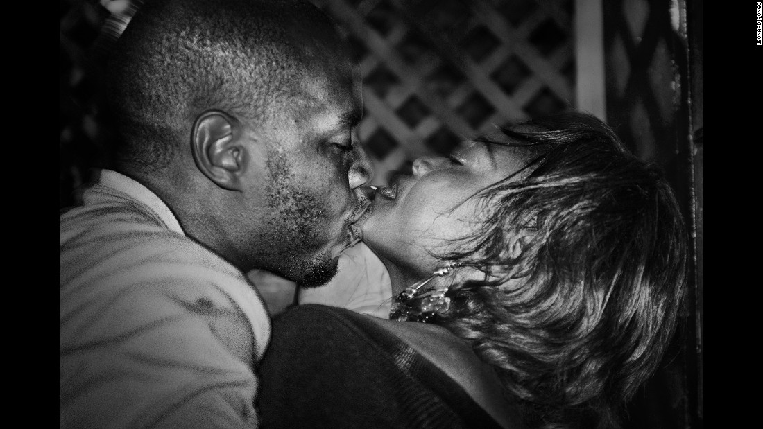 A young man kisses his girlfriend at a bar of the Ewa Bora suburbs of Lubumbashi.
