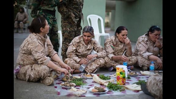 Women gather to eat yaprax, a traditional Kurdish dish.