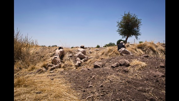 Female Peshmerga train by conducting a mock assault at their base.
