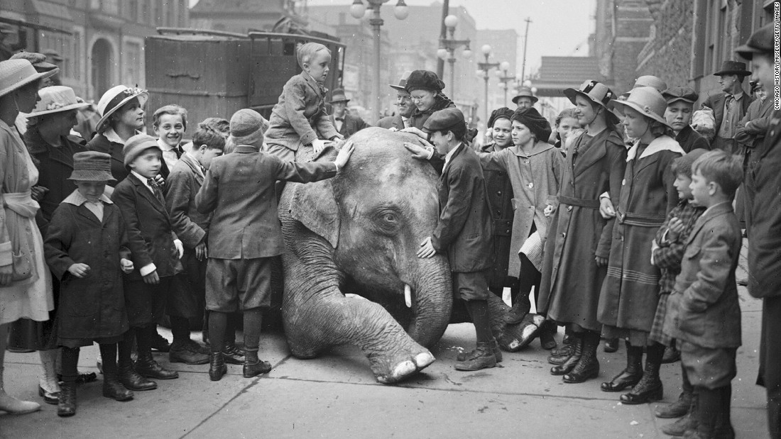 "A blind child in Chicago sits on the back of a kneeling elephant from the Ringling Brothers Circus in April 1917. Ringling Bros. will have elephants perform for the final time Sunday, May 1. It had previously said <a href=""http://money.cnn.com/2015/03/05/news/ringling-bros-circus-elephants/index.html"" target=""_blank"">that all of its elephants would be retired by 2018, </a>but the retirement came early."