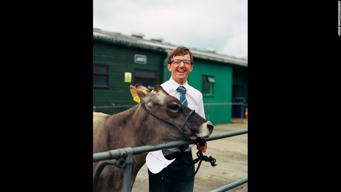 "Jamie, 15, prepares to exhibit his Jersey cow at a livestock show in Somerset, England. Photographer Jooney Woodward thought his cheerfulness showed that ""sense of enjoyment"" handlers have when competing with their animals."