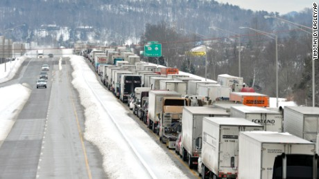 Traffic backs up as more than 50 miles of Interstate 65 southbound is shut down from the weather, Thursday, March 5, 2015, in Mount Washington, Ky. Kentucky State Police reported that the interstate will not reopen until Thursday evening. Kentucky has been walloped by a winter storm that has dumped nearly 2 feet of snow in parts of the state. (AP Photo/Timothy D. Easley)