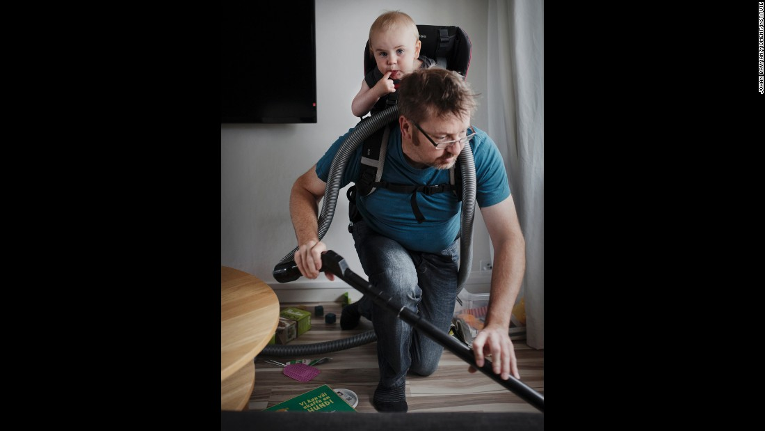 Ola Larsson, 41, works around the house with his son Gustav.