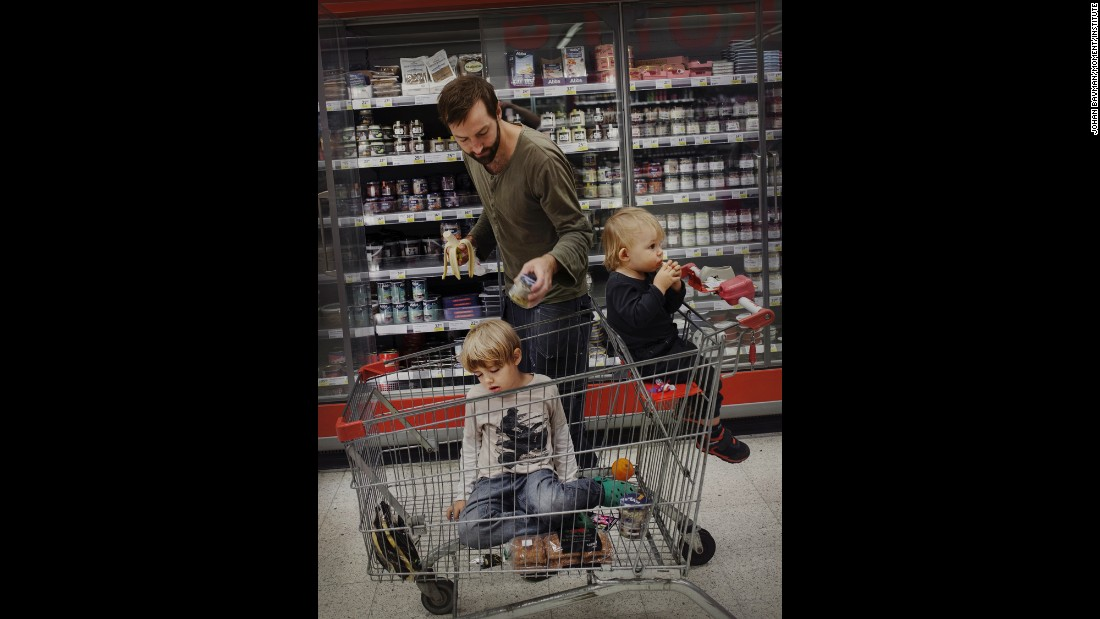 Marcus Bergqvist, 33, shops with his sons Ted and Sigge.